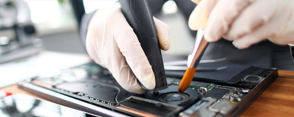 como limpiar teclado portatil